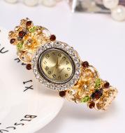 Flower-encrusted hollow watch