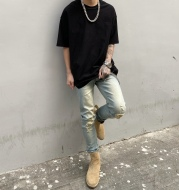 Washed yellowish worn slim fit frayed jeans
