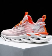 Sports and leisure flying woven mesh shoes