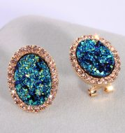 Blue oval diamond color-changing earrings