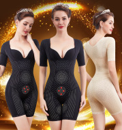 Body toning jumpsuit with belly girdle and waist lift