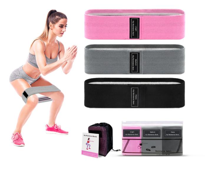 femme-entrainement-mini-bande-resistance-muscles-maison-sportive-fitness