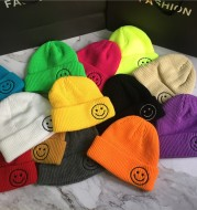 Embroidered smiley knitted hat