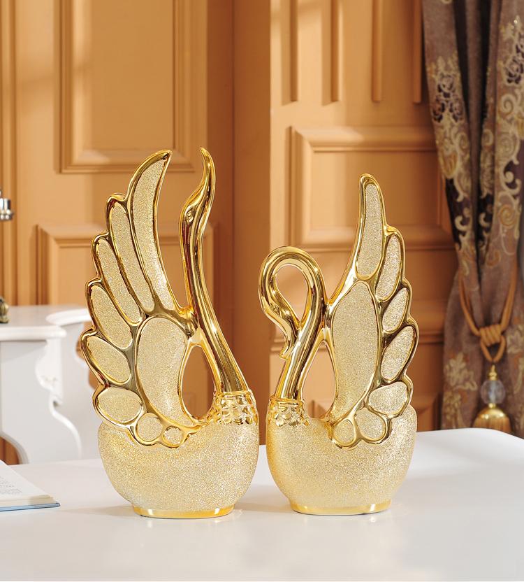 1028438730041 - Adornos de cisne bañados en oro