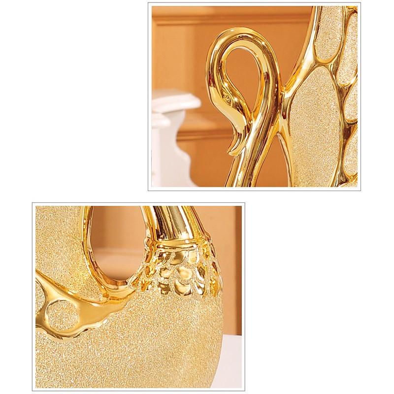1243220406444 - Adornos de cisne bañados en oro