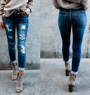 Frayed white ripped slim fit jeans