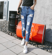 High-waisted ripped jeans woman