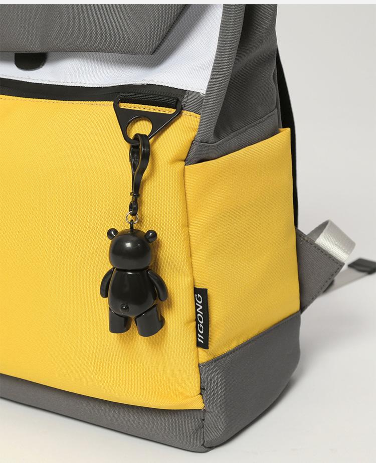 Foto lateral mochila Ghost Destruction Blade anime amarilla enganche para llavero