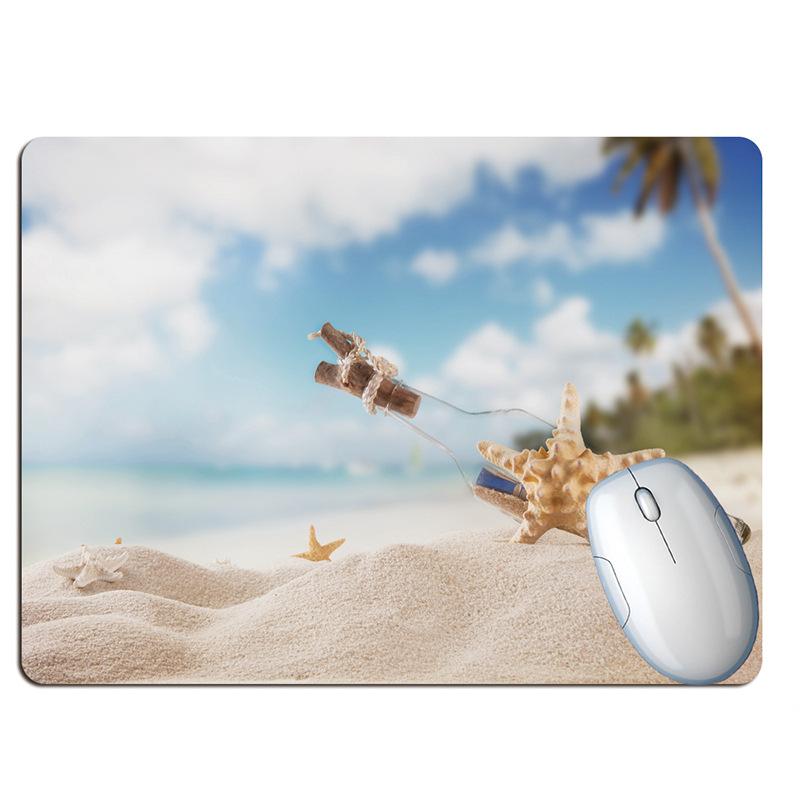 Tapis de souris paysage plage paradisiaque sable
